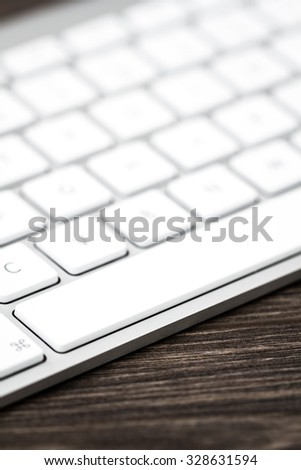 Close up of a modern white, gray computer keyboard. Focus on space bar. - stock photo