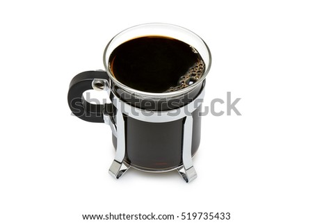 Close up of a mug in glass with dark black coffee isolated on with with clipping path