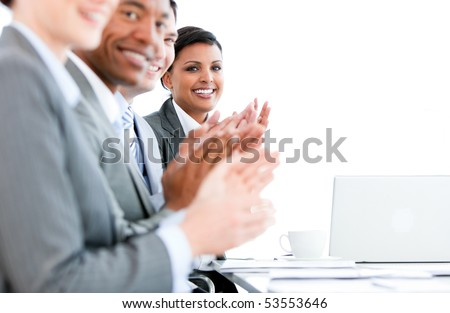 Close up of a multi-ethnic business team applauding a presentation in the office - stock photo