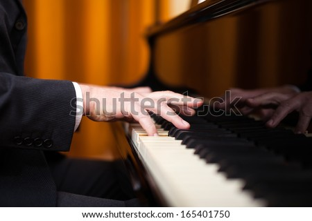 Close up of a musician playing a piano keyboard - stock photo