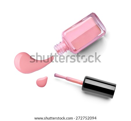 close up of a nail polish bottle and drop on white background - stock photo