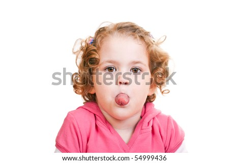 close-up of a naughty little girl sticking out tongue