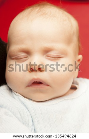 Close-up Of A New Born Baby Sleeping - stock photo