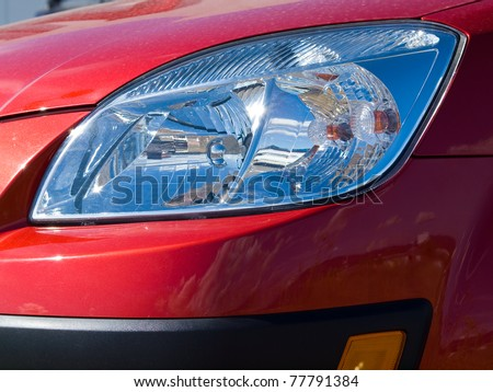 Close Up of a New Car Headlight - stock photo