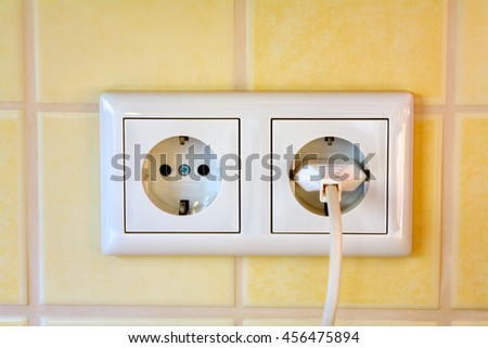 Close up of a new modern  wall socket (Germany), - stock photo