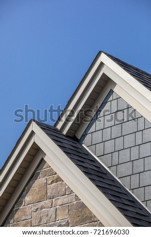 Close up of a new roof on top of a house.