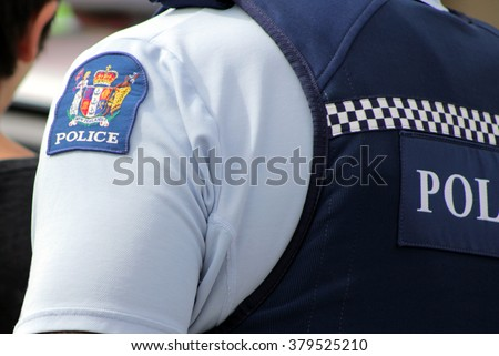 Close up of a New Zealand police officer's uniform and badge - stock photo