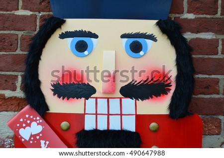 Close-up of a nutcracker Christmas decoration in front of a brick wall