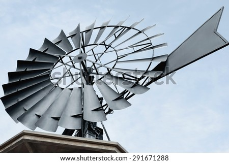 Close up of a of a water pumping windmill. Environment concept. - stock photo