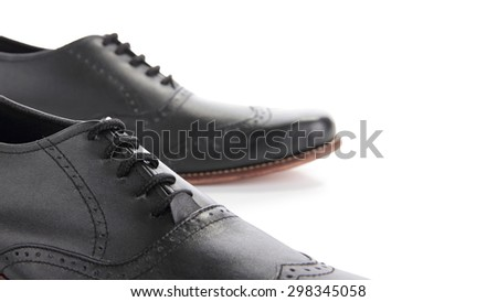 Close up of a pair of formal shoes, selective focus, isolated over white background for copy space - stock photo