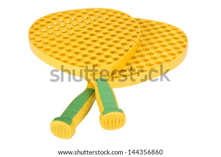 Close-up of a pair of toy tennis rackets - stock photo
