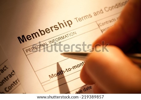 Close up of a pen and blank membership form.