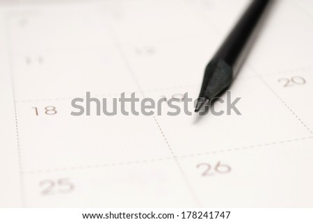 Close-up of a pen on a schedule planner