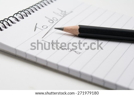 Close up of  a pencil and a notepad - stock photo