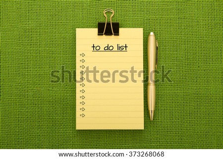 Close up of a pencil and a notepad written to do list on it - stock photo