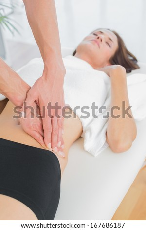 Close-up of a physiotherapist massaging woman's body in the medical office