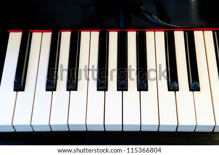 Close-up of a piano keyboard with white keys