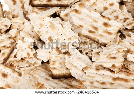 Close up of a pile of broken pieces of Jewish Matzah bread, the substitute for bread on the Jewish Passover holiday. - stock photo