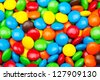 Close up of a pile of colorful chocolate coated candy - stock photo