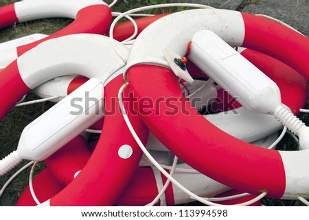 Close up of a pile of dirty lifesaving buoys