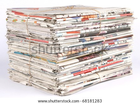 Close up of a pile of newspaper- shallow DOF on corner stack