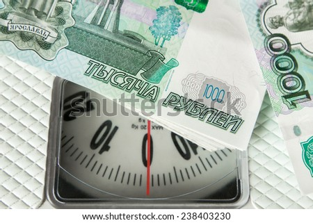 Close-up of a pile of russian banknotes on the electronic weight - stock photo