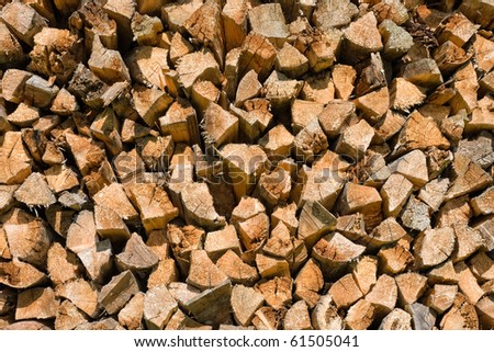 close-up of a pile of wooden logs for use as firewood - stock photo