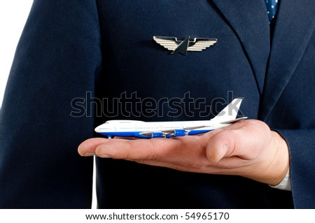 close-up of a pilot's arm holding a small plane - stock photo