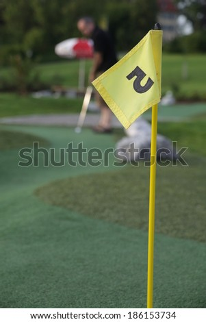 Close up of a pin and cup on a golf hole