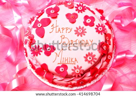 Close up of a pink birthday cake  - stock photo