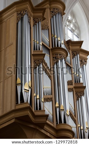 Close-up of a pipe organ in a Cathedral - stock photo