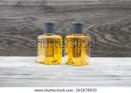 close up of a plastic soap bottle on wood - stock photo