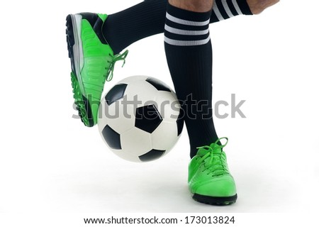 Close-up of a player's feet playing the ball - stock photo