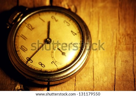 close up of a pocket watch on wood background - stock photo