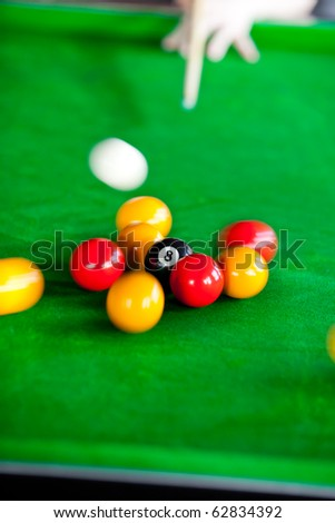 Close-up of a pool player in a club - stock photo