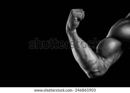 Close-up of a power fitness man's hand. Strong and handsome young bodybuilder demonstrate his muscles and biceps. Black and white photo with copy space