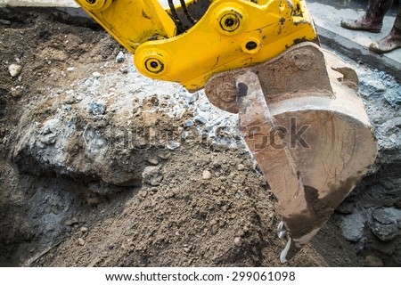 Close up of a power shovel/excavator digging road.  - stock photo