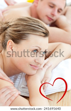 Close up of a pretty woman having a message with her boyfriend against heart - stock photo