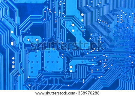 Close up of a printed blue computer circuit board - stock photo