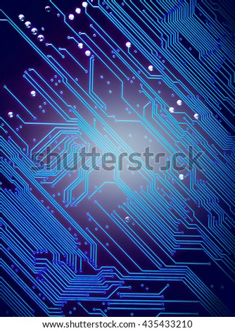 Close up of a printed blue computer circuit board with Vignette effect tone - stock photo