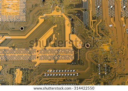 Close up of a printed computer circuit board in blue tone style.Technology concept. - stock photo