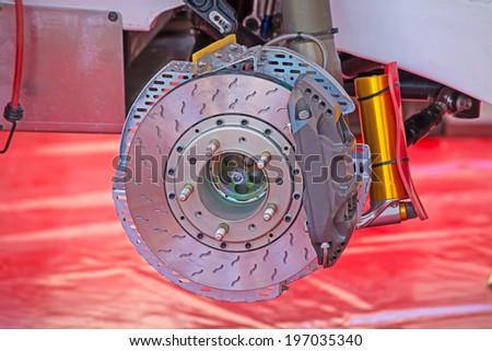 close up of a rally car disk brake  - stock photo