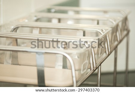 Close up of a range of empty baby containers in the maternity hospital  - stock photo