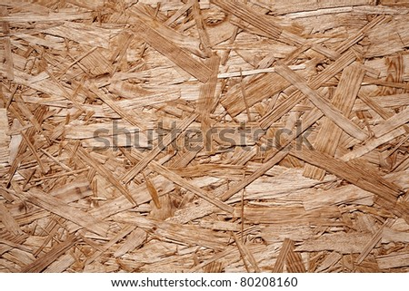 Close up of a recycled compressed wood chippings board - stock photo