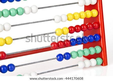 close up of a red abacus with multicolored balls