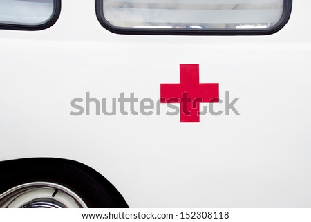 Close up of a red cross on a vintage ambulance - stock photo