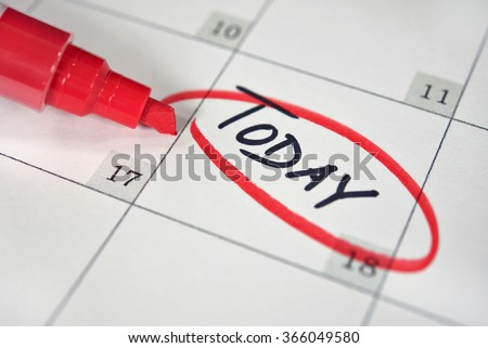 close up of a red marker circling a reminder on calendar date - stock photo