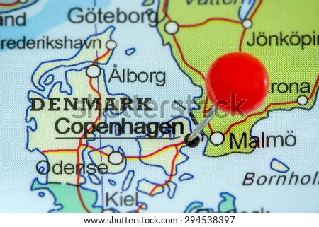 Close-up of a red pushpin on a map of Copenhagen, Denmark