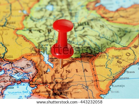 Close-up of a red pushpin on a map of Kenia  Africa - travel concept - stock photo