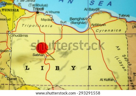 Close-up of a red pushpin on a map of Libya - stock photo